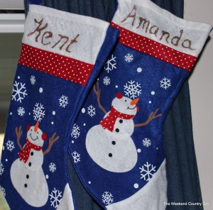 I found these stockings at a 99 cent store then added the names with a glitter pen.  It is fun to see the kiddos' stockings up on the curtains.