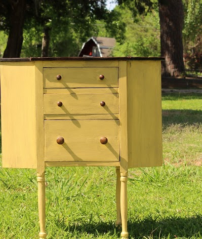 yellow sewing cabinet