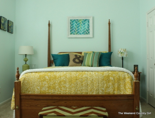 Yellow bedding in blue room